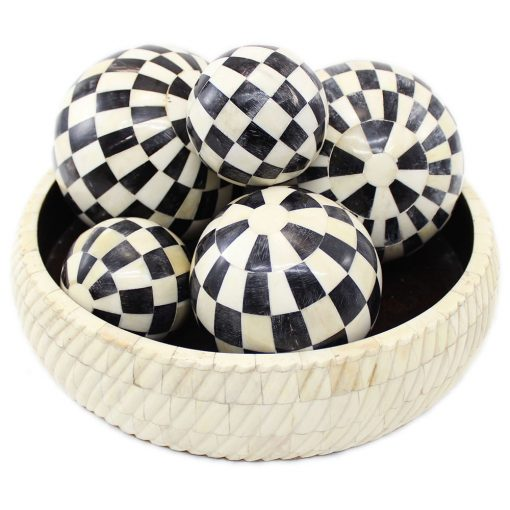 black decorative balls in bowl